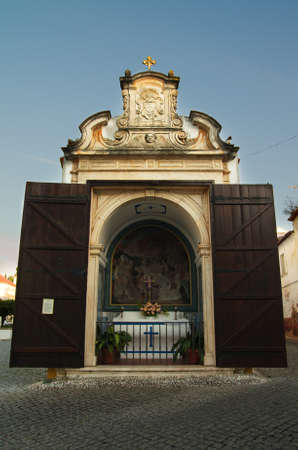 Way of the Cross (Via Sacra) station. A christian small chapel with large wood doors wide open at Vila Vicosa. Alentejo, Portugal.