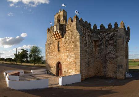 Lateral view of Boa-Nova Chapel or Sanctuary of Nossa Senhora da (Our Lady of) Boa-Nova. A rare case of a fortified church dating of fourteenth century. Terena, Alentejo, Portugal.