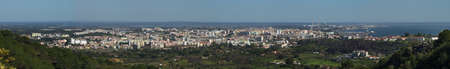 Panorama of Setubal city, river Sado estuary and the harbour as seen from the base of Saint Luis mountain range. Portugal.