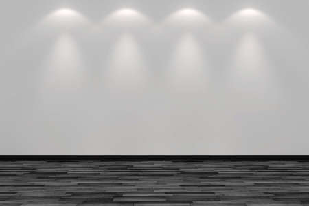 vlank room wall lit by four spot lights
