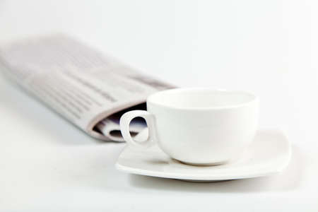 white coffee cup and newspaper isolated on white photo