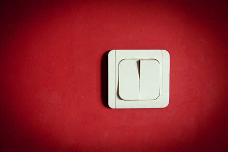 white light switch on red wall Stock Photo - 8634365