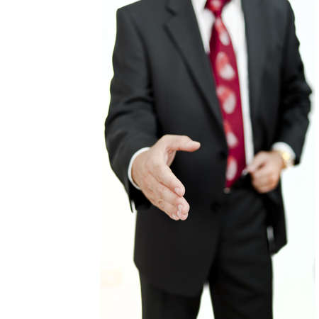 life partner: close up view of business man extending hand to shake Stock Photo