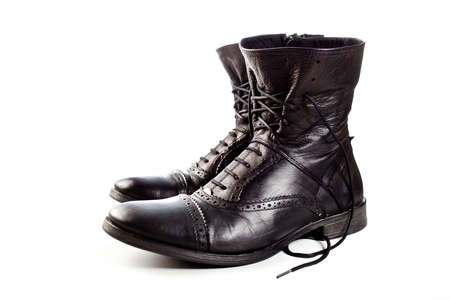 black leather boots on ahite background photo
