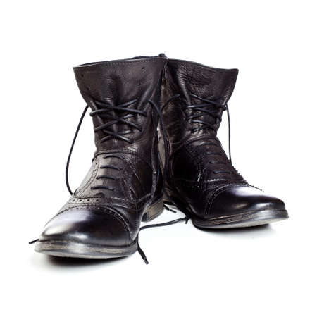 combat boots: black leather boots on ahite background Stock Photo