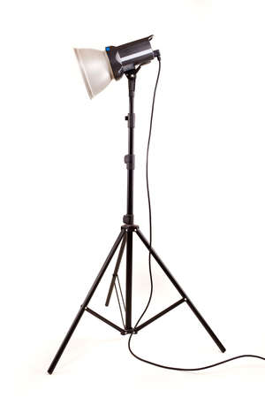 studio monoblock flash light on tripod isolated on white background photo