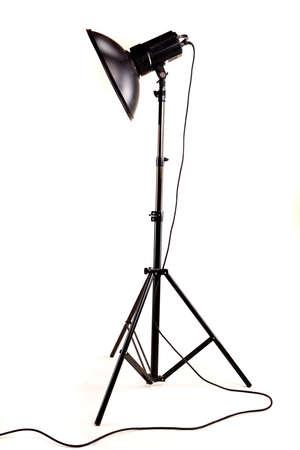 lamp stand: studio monoblock flash light on tripod isolated on white background Stock Photo