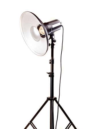 tubus: studio monoblock flash light on tripod isolated on white background Stock Photo