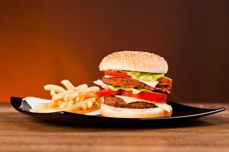 Fast food tasty hamburger and franch fries photo