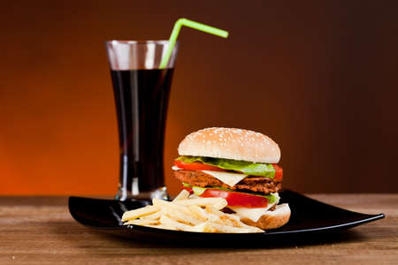 Fast food tasty hamburger  with franch fries and soda photo