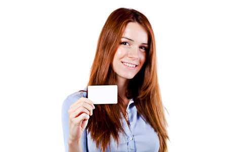 sales meeting: portrait of an atractive young business woman presenting a business card