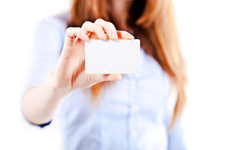 show cards: portrait of an atractive young business woman presenting a business card