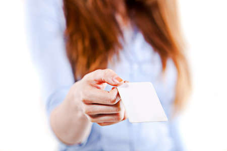 portrait of an atractive young business woman presenting a business card photo