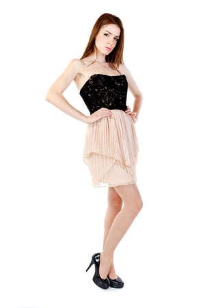 Beautiful woman wearing an elegant dress, over white background posing in studio.Fashion photo. photo