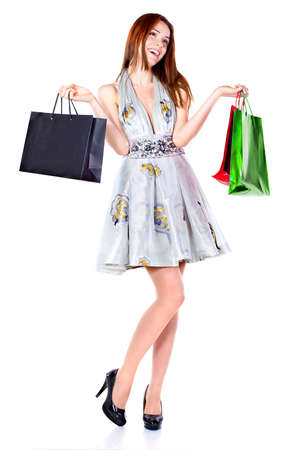 Attractive young beautiful woman with shopping bags over white background. photo
