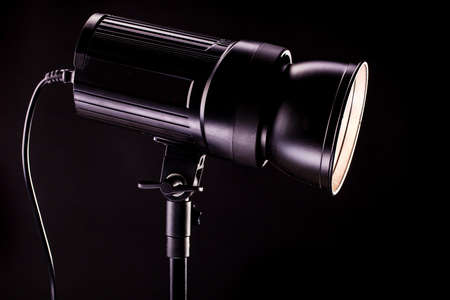 tubus: studio light strobes on black background Stock Photo