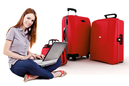 suitcases: beautiful young woman online trip planning with 3d luggage in the background