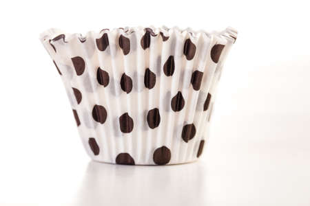 empty muffin cups, on white background photo