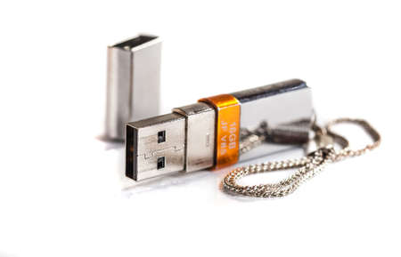 silver usb stick on white background photo