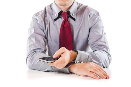 close up of a business man using a mobile phone photo