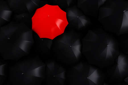 3d red umbrella on top of black umbrellas photo