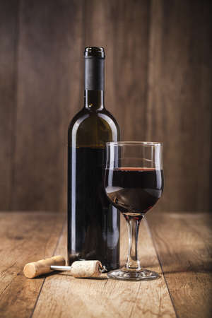 red wine on wooden background still life image photo