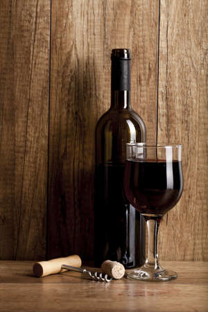 red wine on wooden background still life image Stock Photo