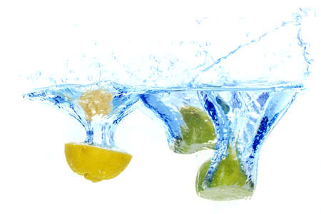 fresh lemons splash into water on white background photo