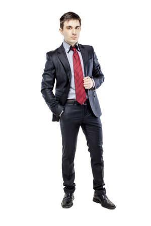man in suite: young attractive business man in black suite on white background Stock Photo