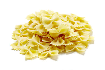 close-up of raw pasta on white background photo
