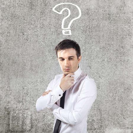 confused businessman on grunge background photo