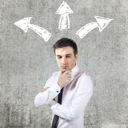 the view option: confused businessman on grunge background