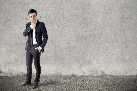 the view option: portrait of young businessman on grunge background
