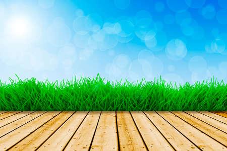 fond avec l'herbe verte fraîche, plancher de bois et de ciel bleu Banque d'images