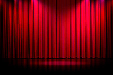 3d red curtain lit by spot lights photo