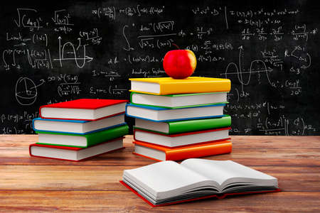 blackboard cartoon: 3d books and apple, school background Stock Photo