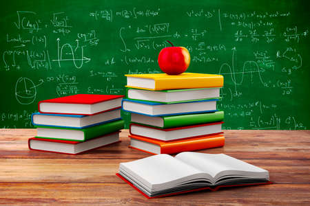 black board: 3d books and apple, school background Stock Photo