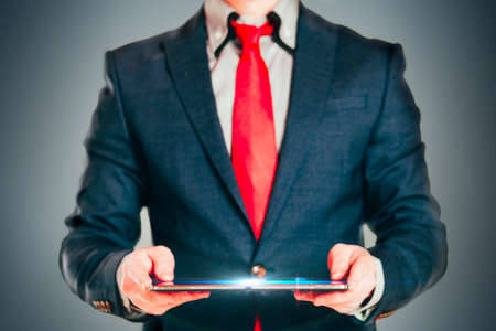 portables: Close up image of business man holding a digital tablet