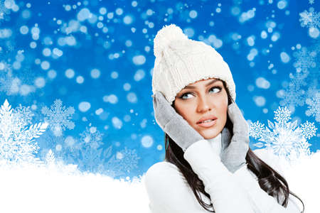 christmas winter: Beautiful woman in winter clothes on Christmas background Stock Photo