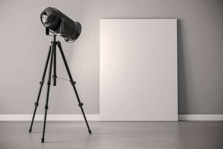 blank canvas: 3d studio light projector and blank canvas frame Stock Photo