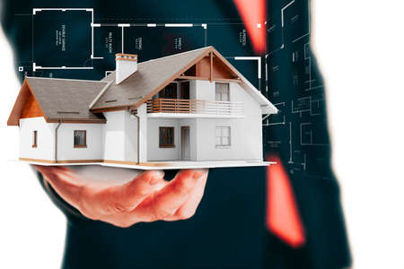 architect drawing: Close-up image of businessman holding a 3d house, architecture project