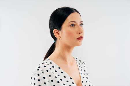 portrait of beautiful brunette woman model in studio against white background Stock Photo