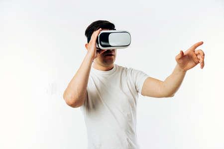 Man in white T-shirt wearing virtual reality 3D headset