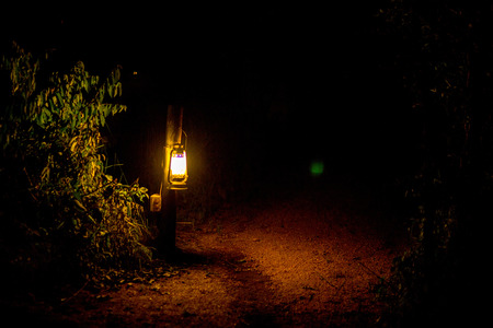 Oil Lantern in Luxury Safari Camp at Night Stock Photo