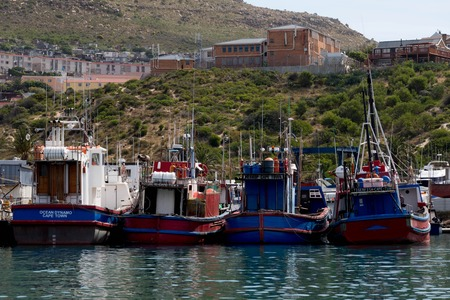 Blue and Red Fishing Boats in Capetown Harbor Editorial