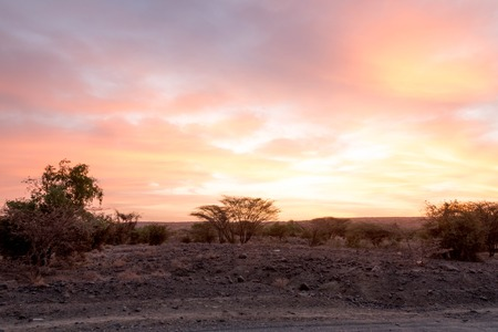 Colourful African Sunset in Desert-like Landscape Stock Photo