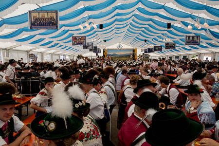 Traditional German Festival with People Seated on Benches in large Festival Tent Editorial