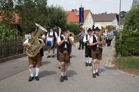 Traditional German Brass Band with Leather Pants on a Village Street