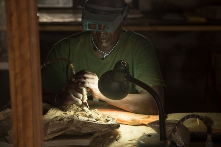 African Paleontologist Working on Fossils Stock Photo