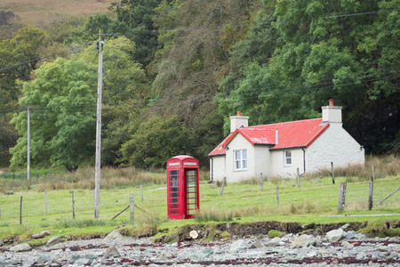 British Telephone Booth in Rural Area Stock Photo